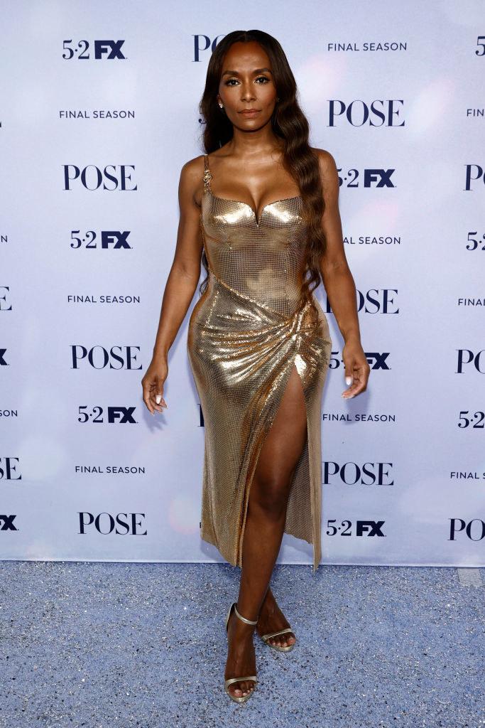 Janet wore a short metallic dress with a high slit