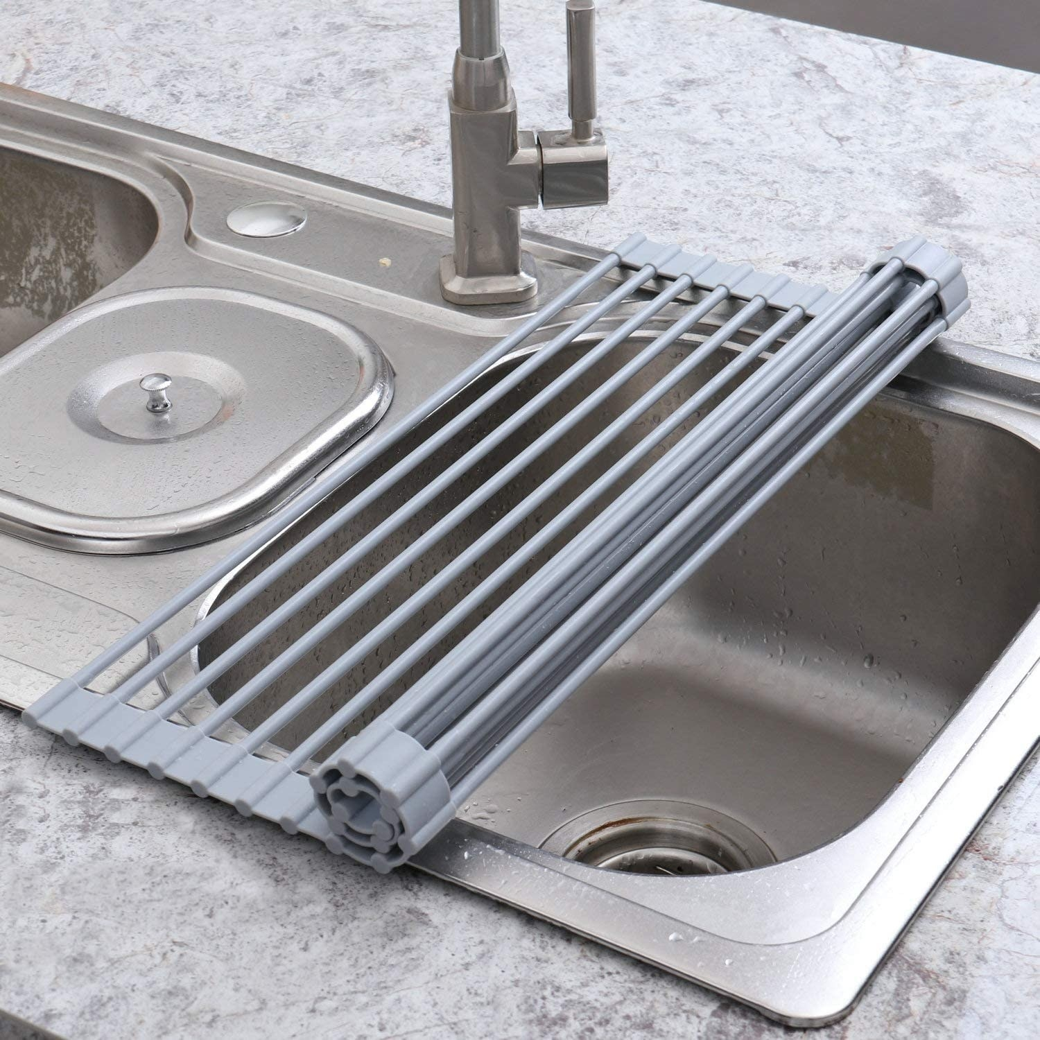 The roll-up drying rack over a sink