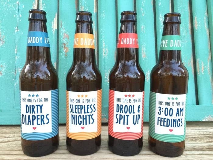 Four beer bottles with labels that say dirty diapers, sleepless nights, drool and spit up, and three am feedings
