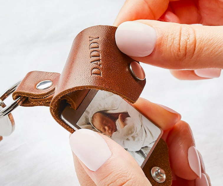 """Leather keyring with a flap that says """"Daddy"""" and a baby photo underneath"""