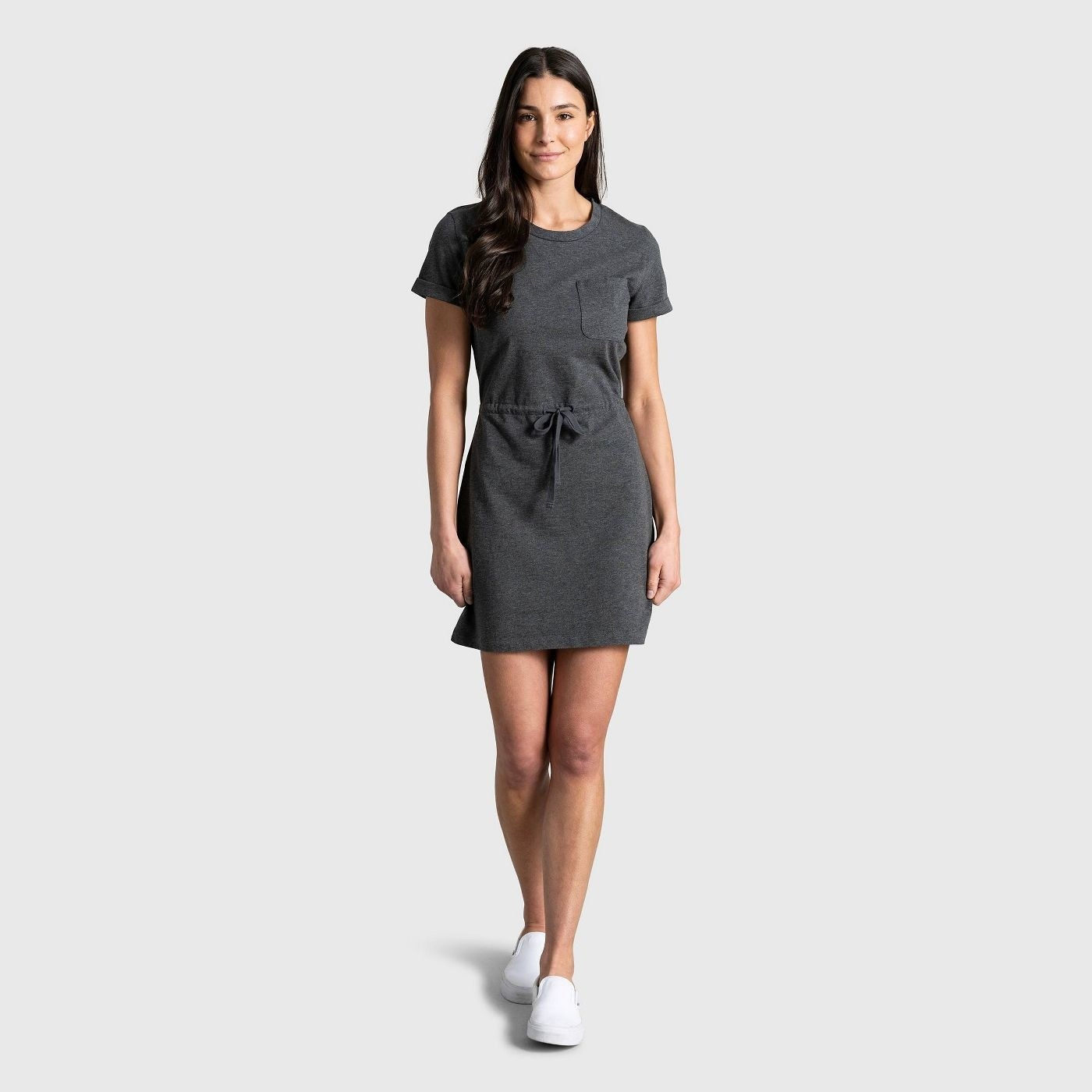 Model wearing short sleeve charcoal dress with pocket