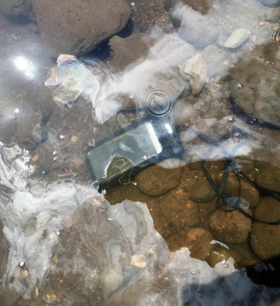 A phone in a case underwater