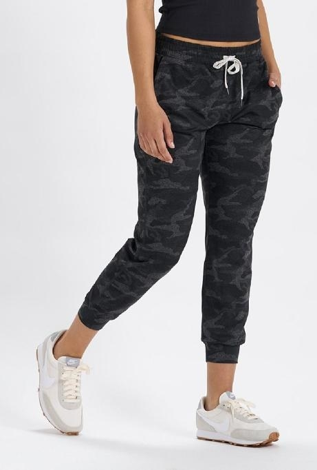 model in gray and black camo print joggers