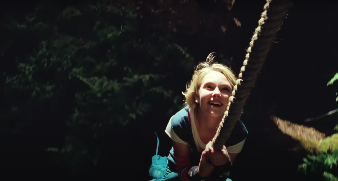 """Leslie from """"Bridge to Terabithia"""" swinging on a rope"""