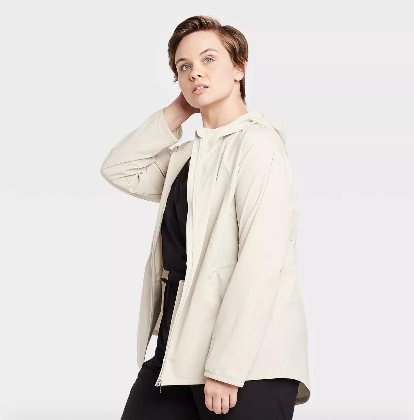model in lightweight white rain jacket