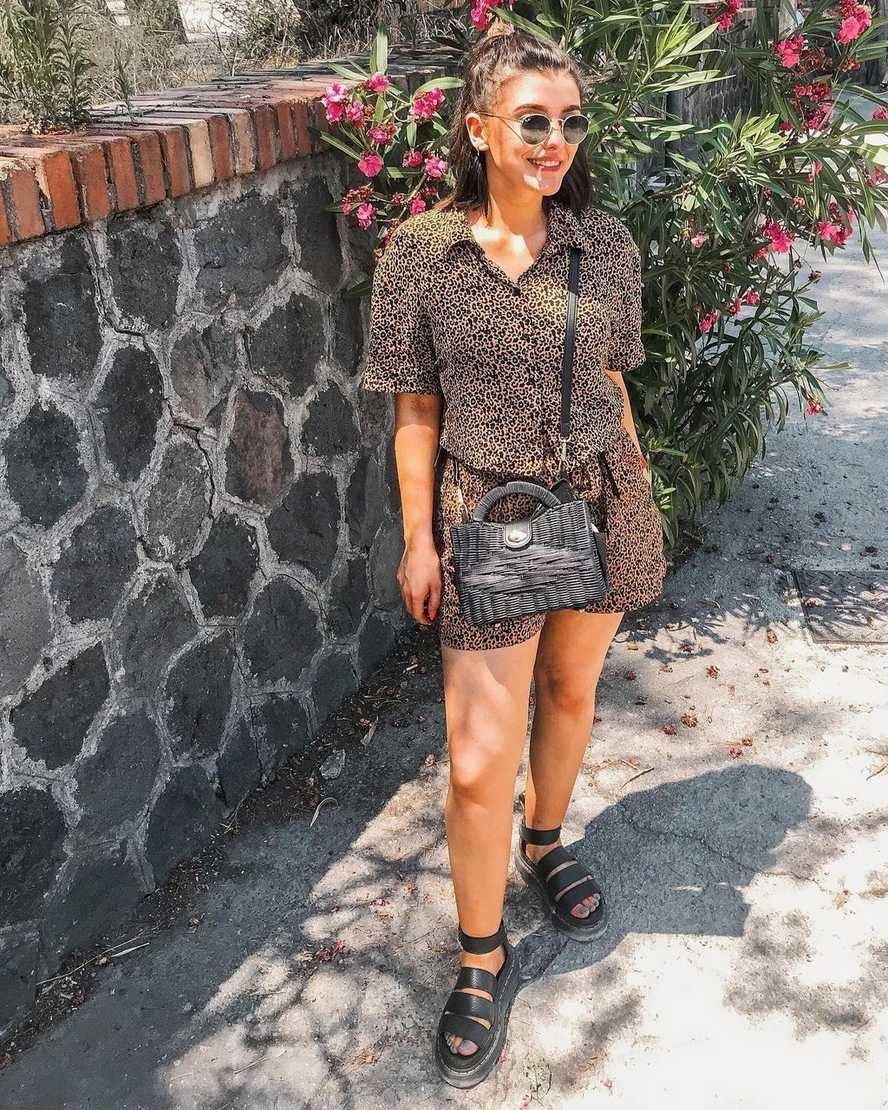 a model wearing the black platform sandals
