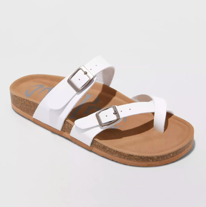 the tan and white sandals with buckles and a toe strap