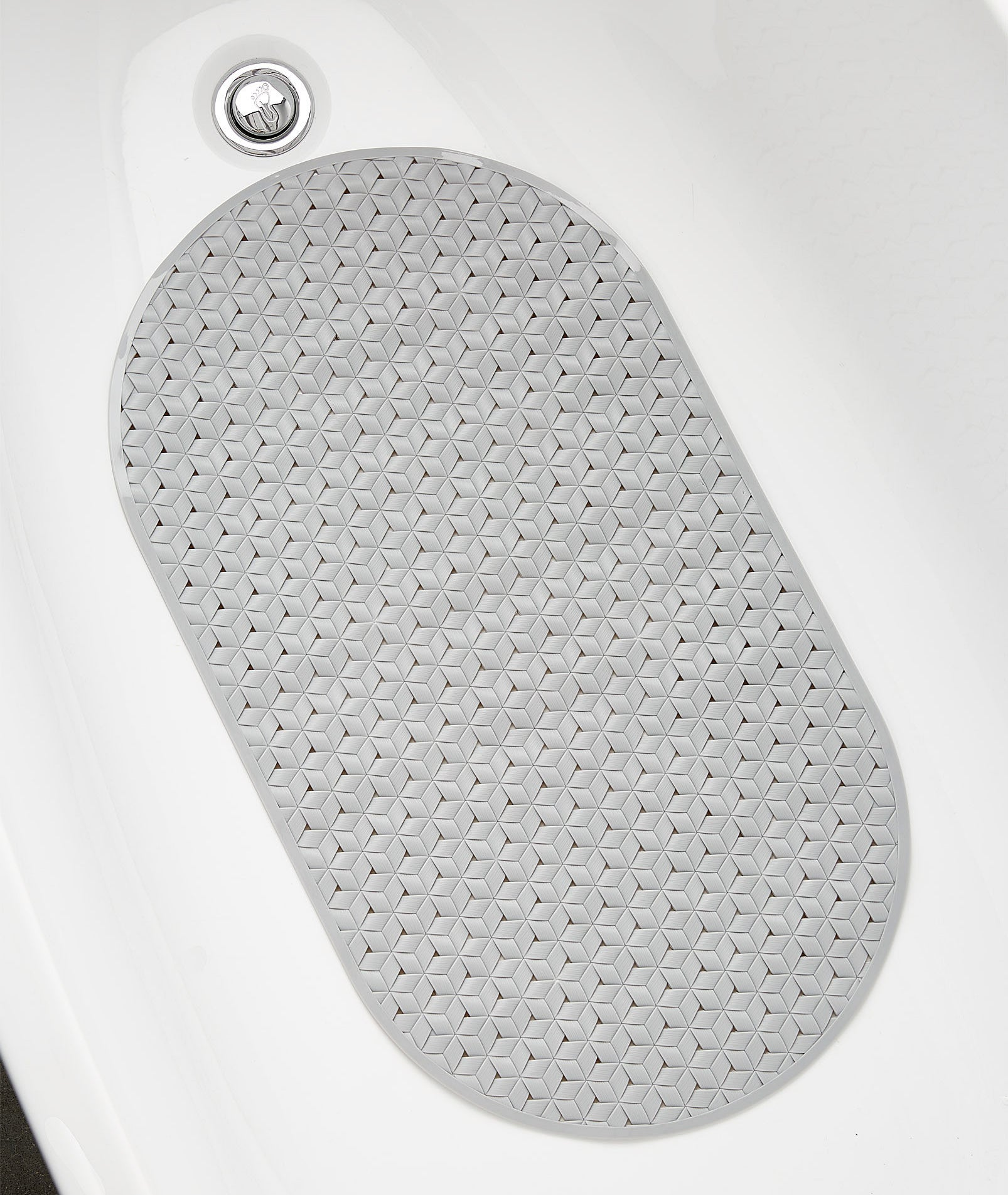A top down view of the woven silicone bath mat inside a tub