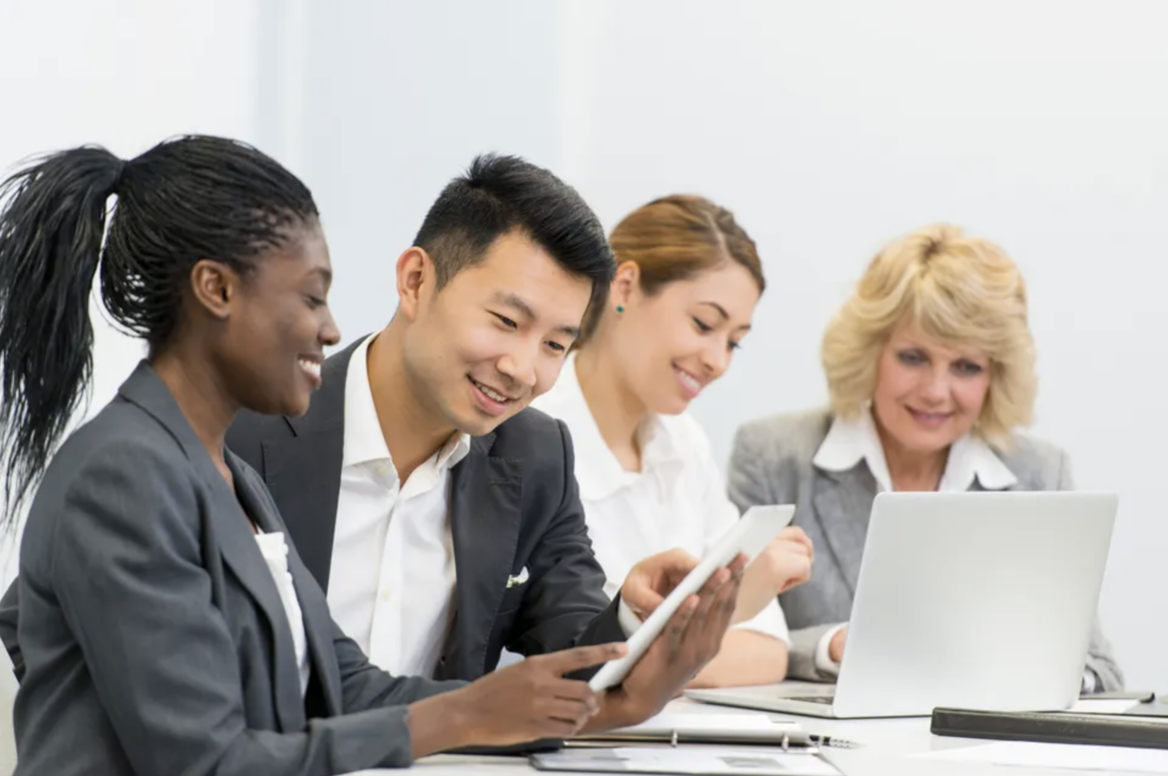 """Stock photo of Simu Liu participating in """"group of business people working in office"""""""