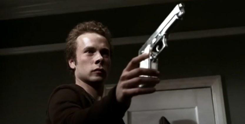 Max holding a gun
