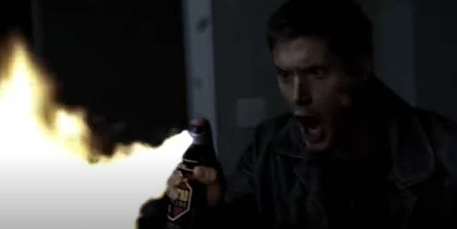 Dean Winchester screaming while spraying flames