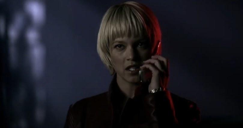 Meg on a flip phone