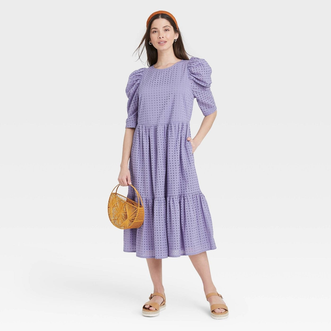 Model wearing lilac midi dress with 3/4 sleeves