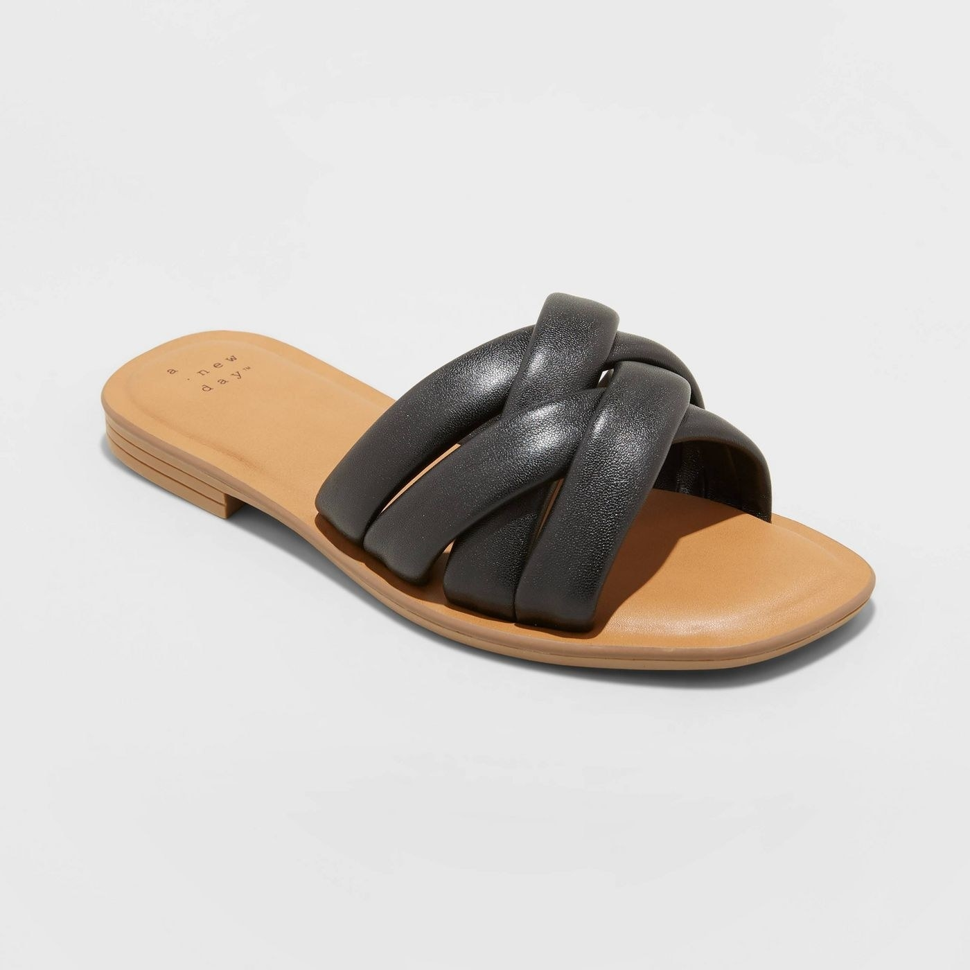 Woven, leather, puff sandal with half an inch heel and beige sole