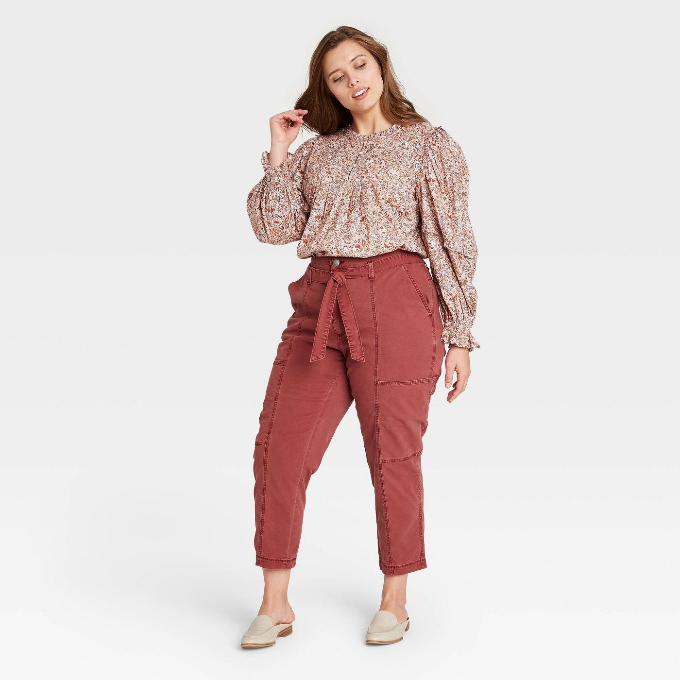 Model wearing burnt red pants tapered texture