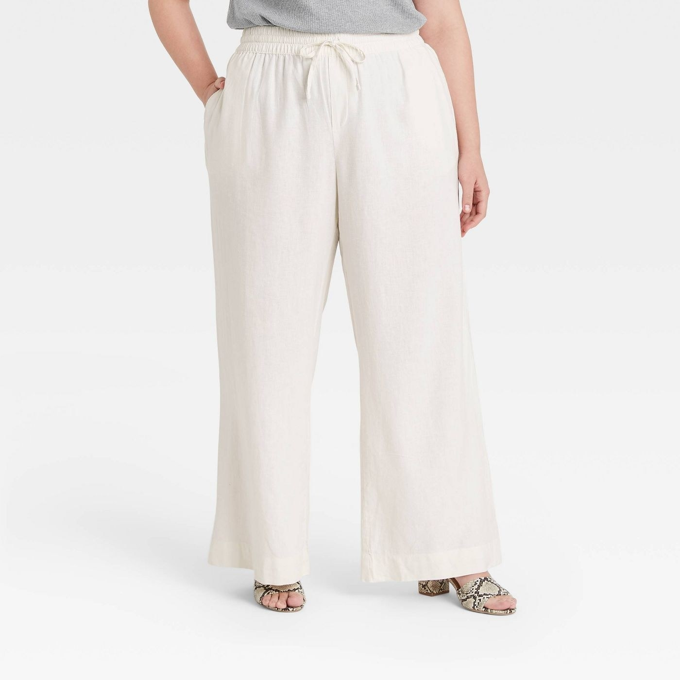 Model wearing off-white pants with an elastic waits band tie