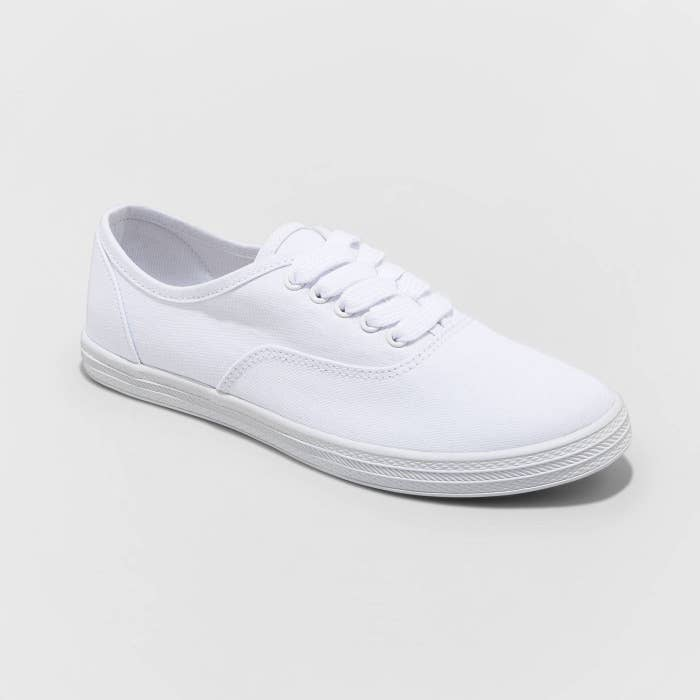 All white sneakers with laces and rubber sole