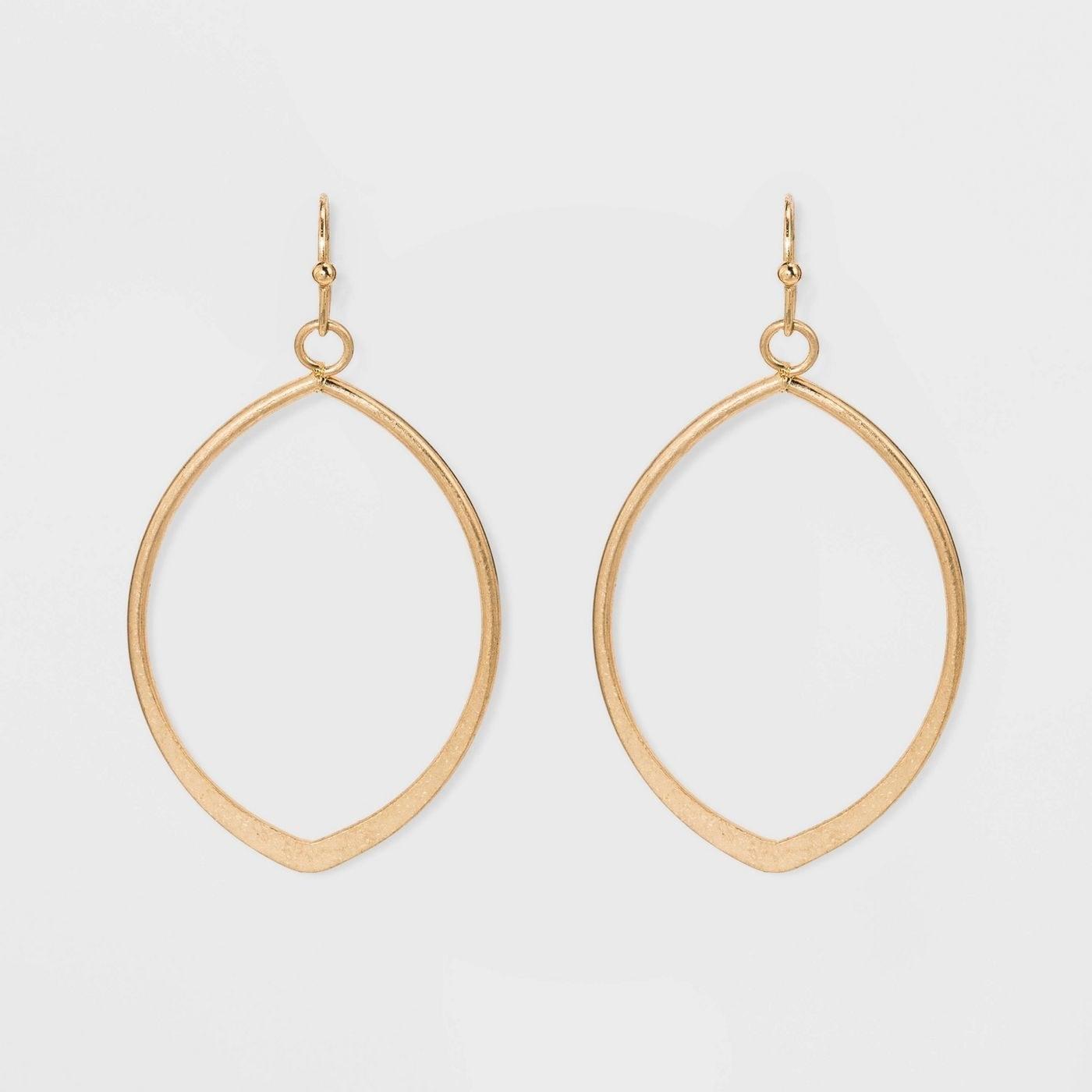 Circular, metal cut earrings with fish hook closure