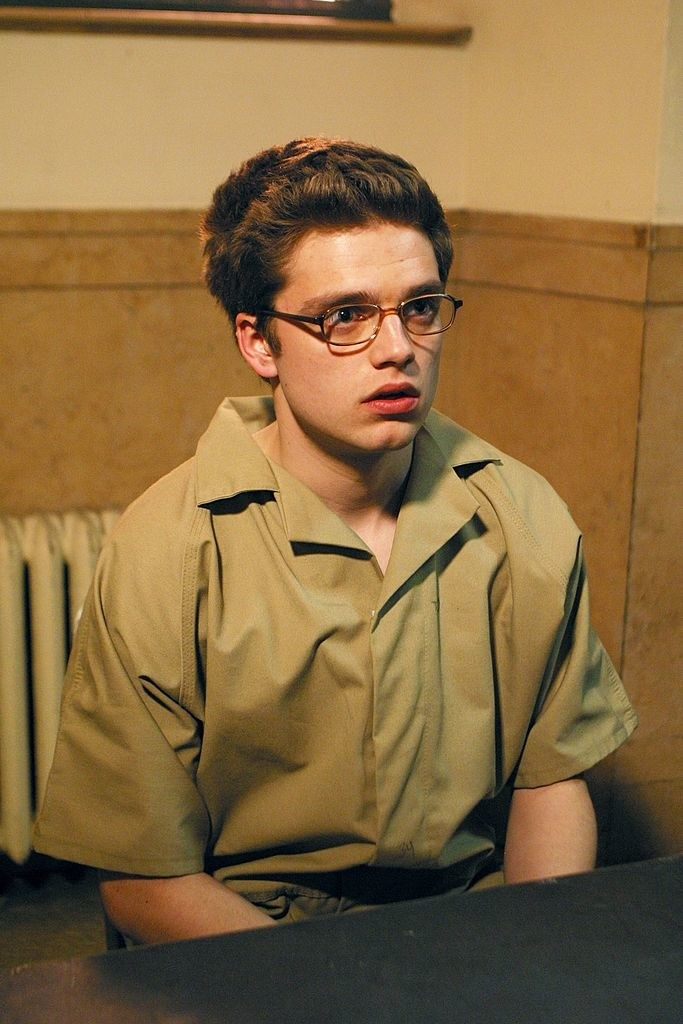 Sebastian wearing a prison outfit and glasses