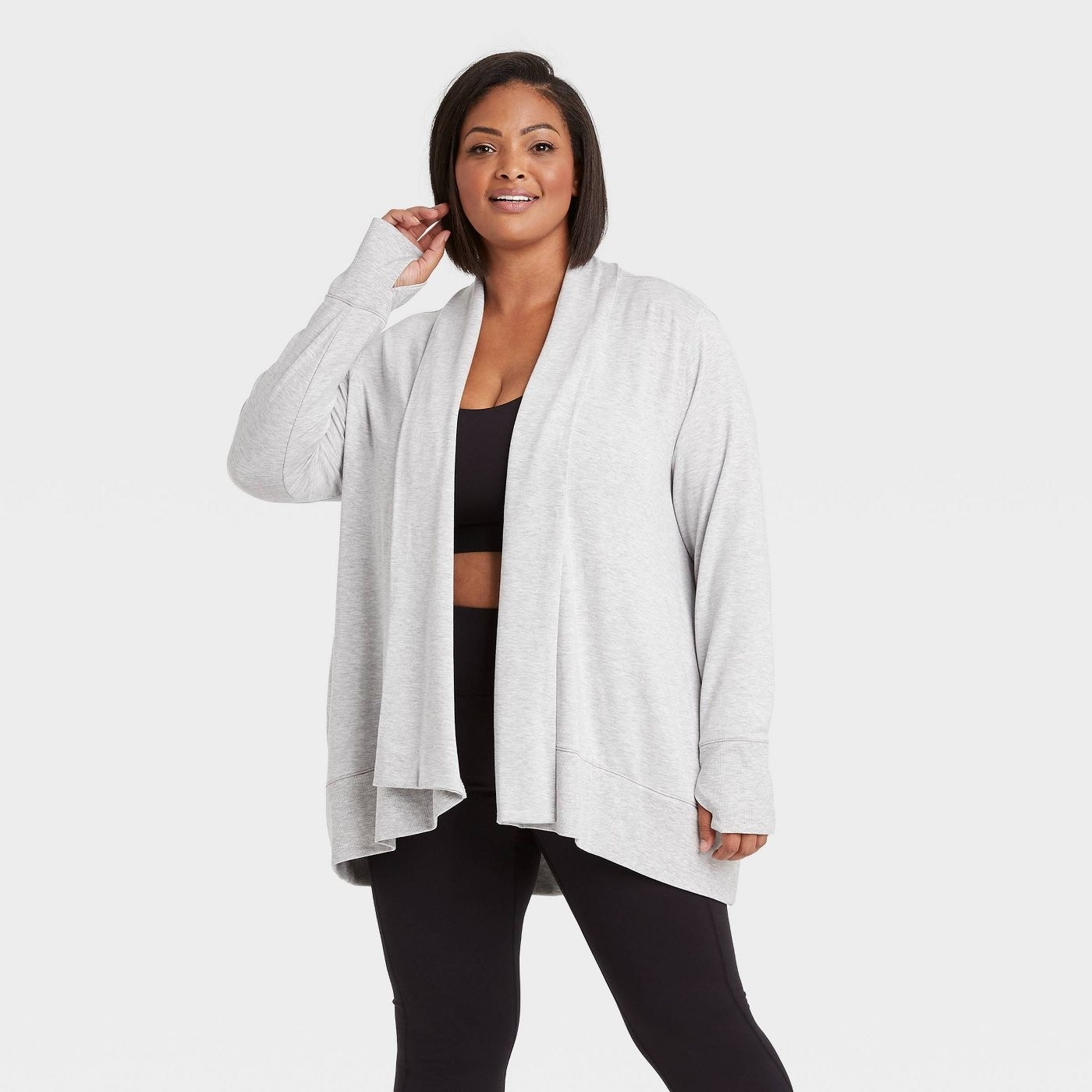 Model wearing long sleeve  heather gray cardigan, stop mid thigh