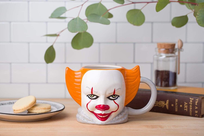 mug shaped like pennywise's mug
