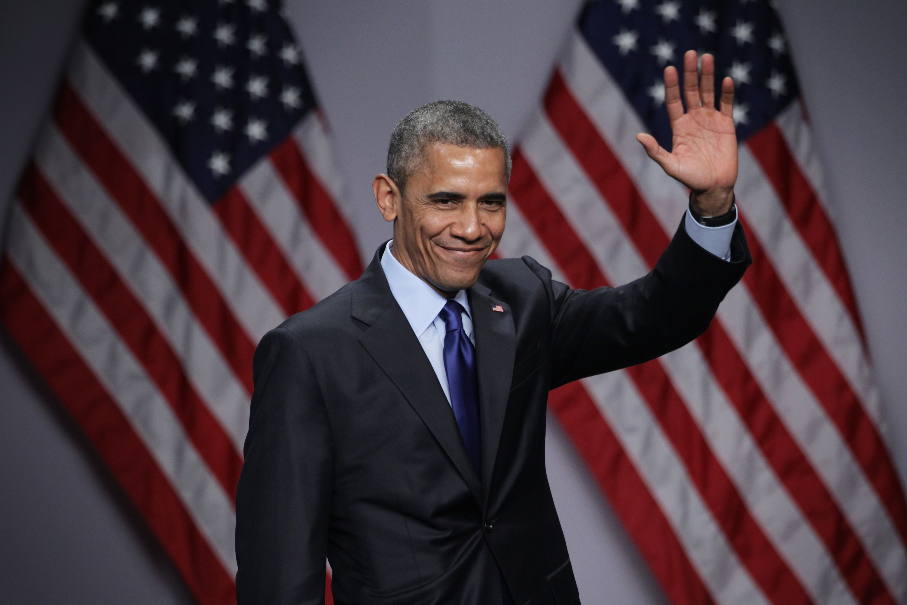 Obama waves at a summit in 2015