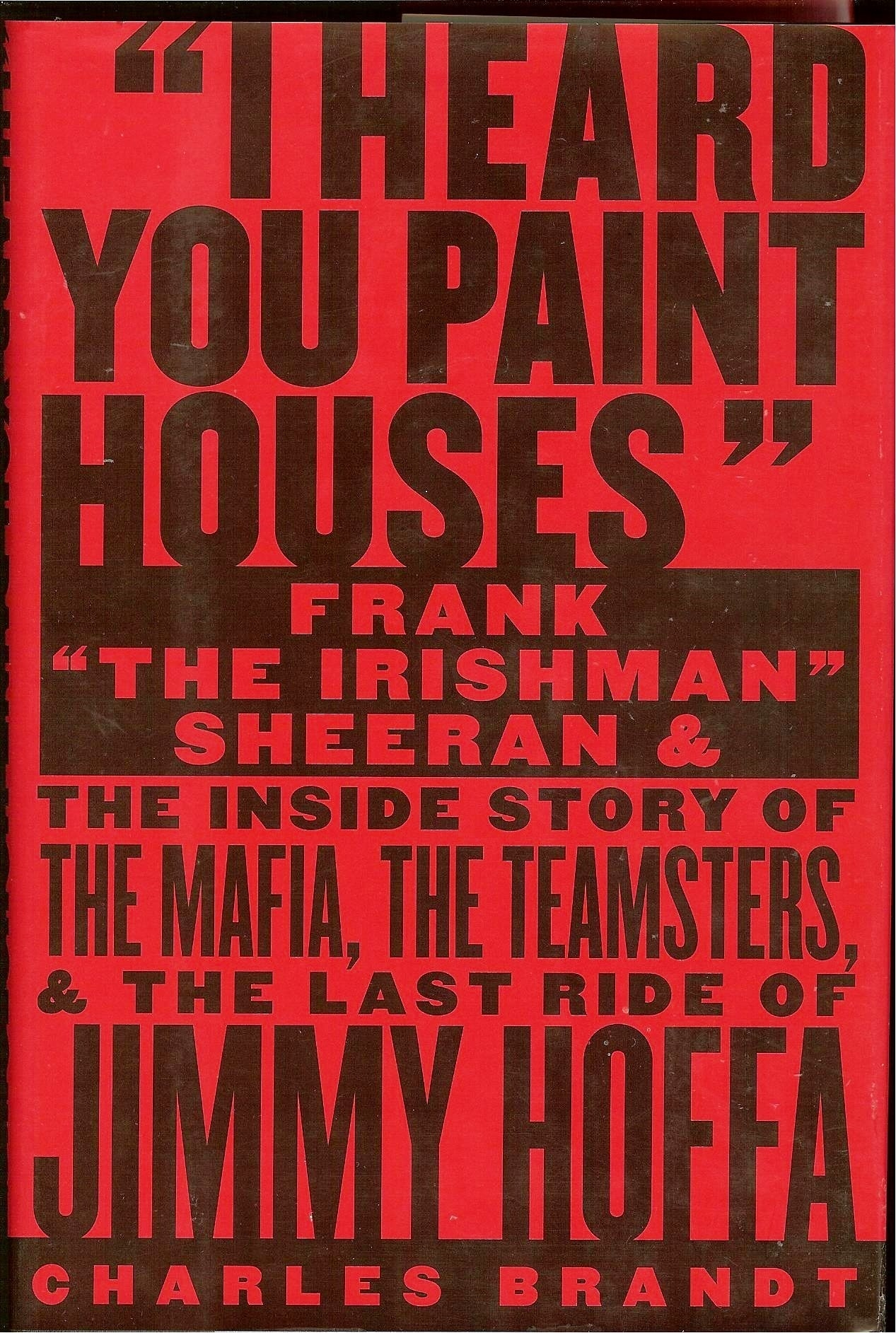 the cover of i heard you paint houses by Charles brandt
