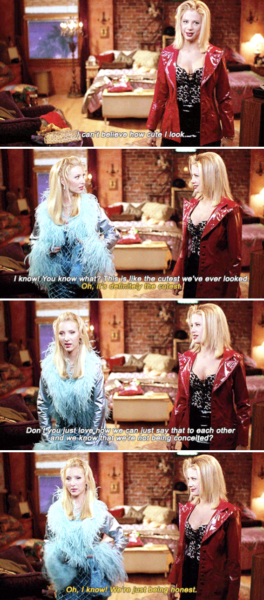 Romy and Michele admiring how cute they look in the mirror in their apartment