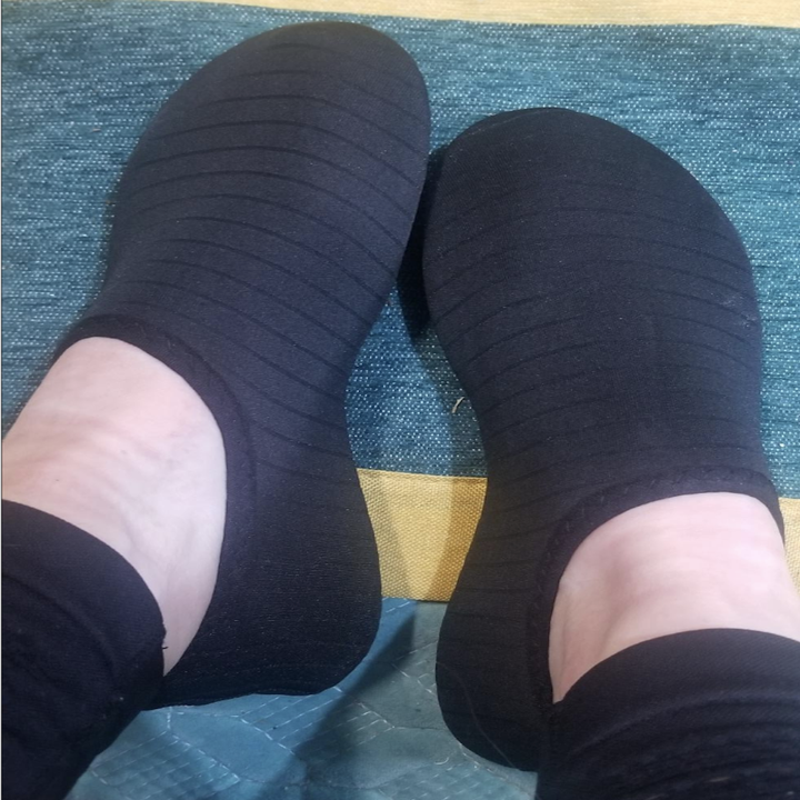 Reviewer image of black formfitting water shoes on feet