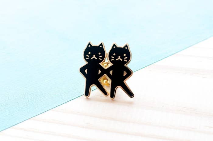 pin of two cats dancing