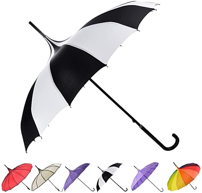 side view of the umbrella with a pointy tip and black and white alternating panels