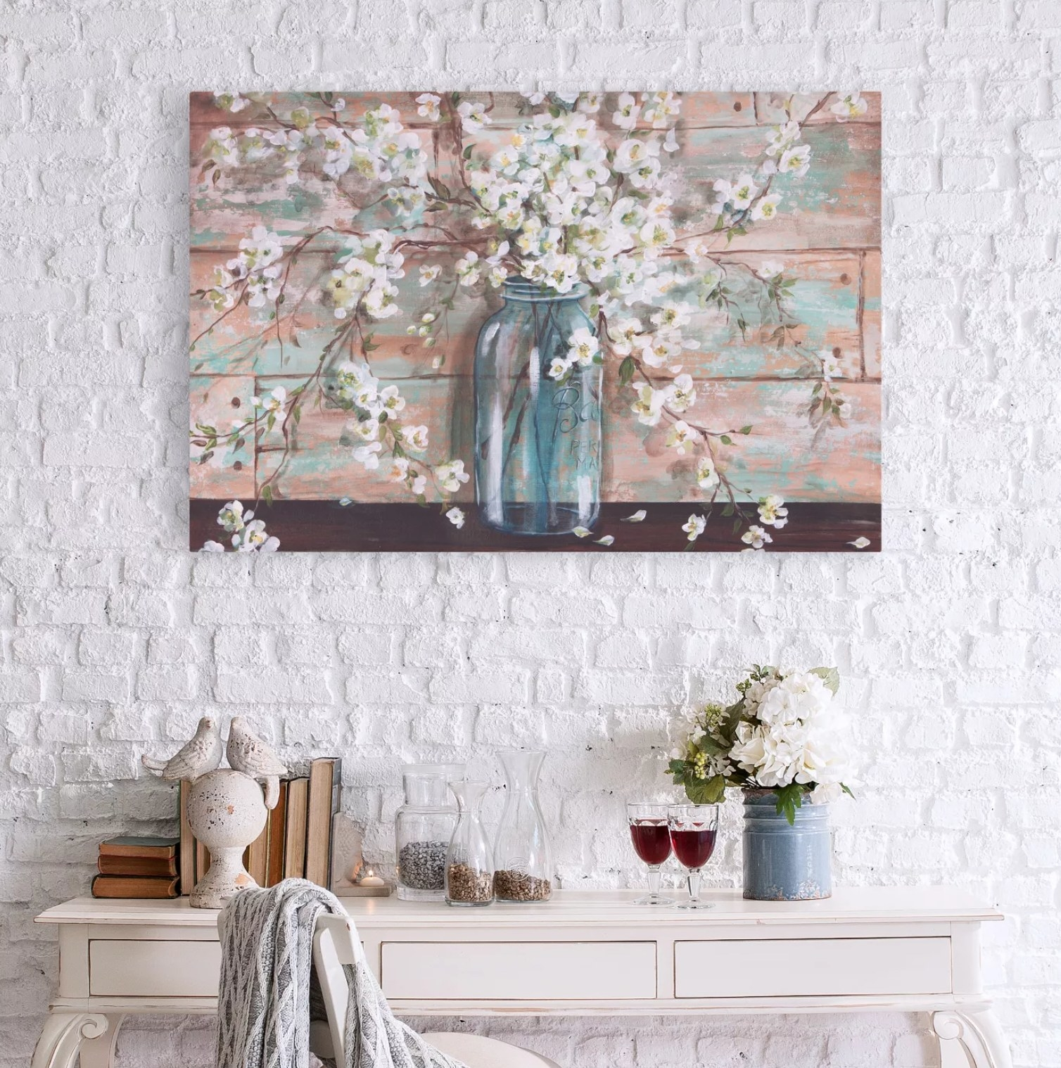 The painting hanging on a wall