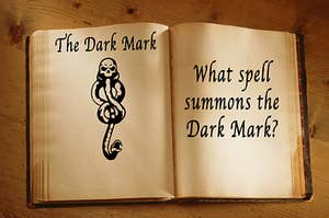 a spell book containing a drawing of the dark mark