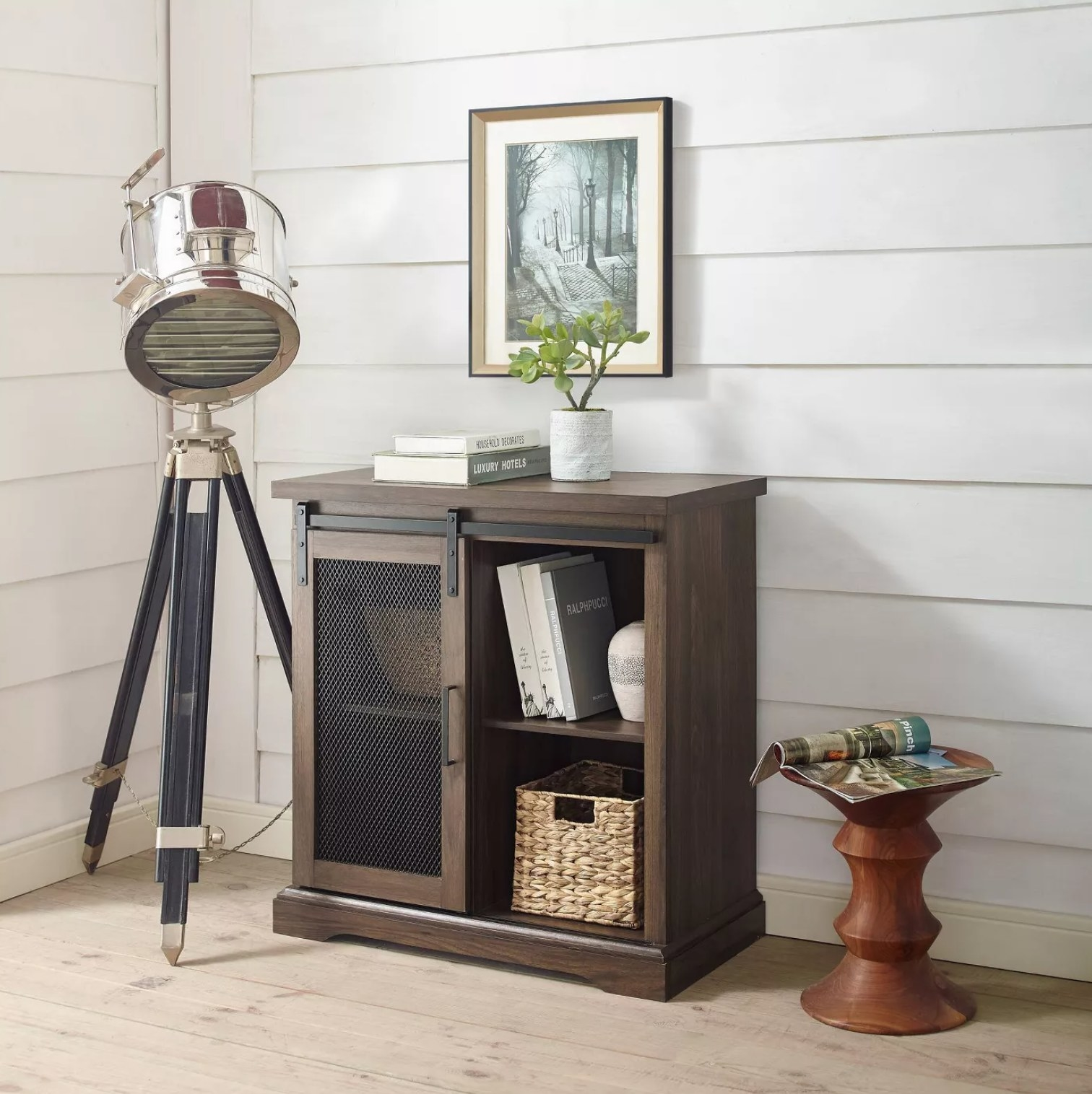 The buffet with books and storage bins