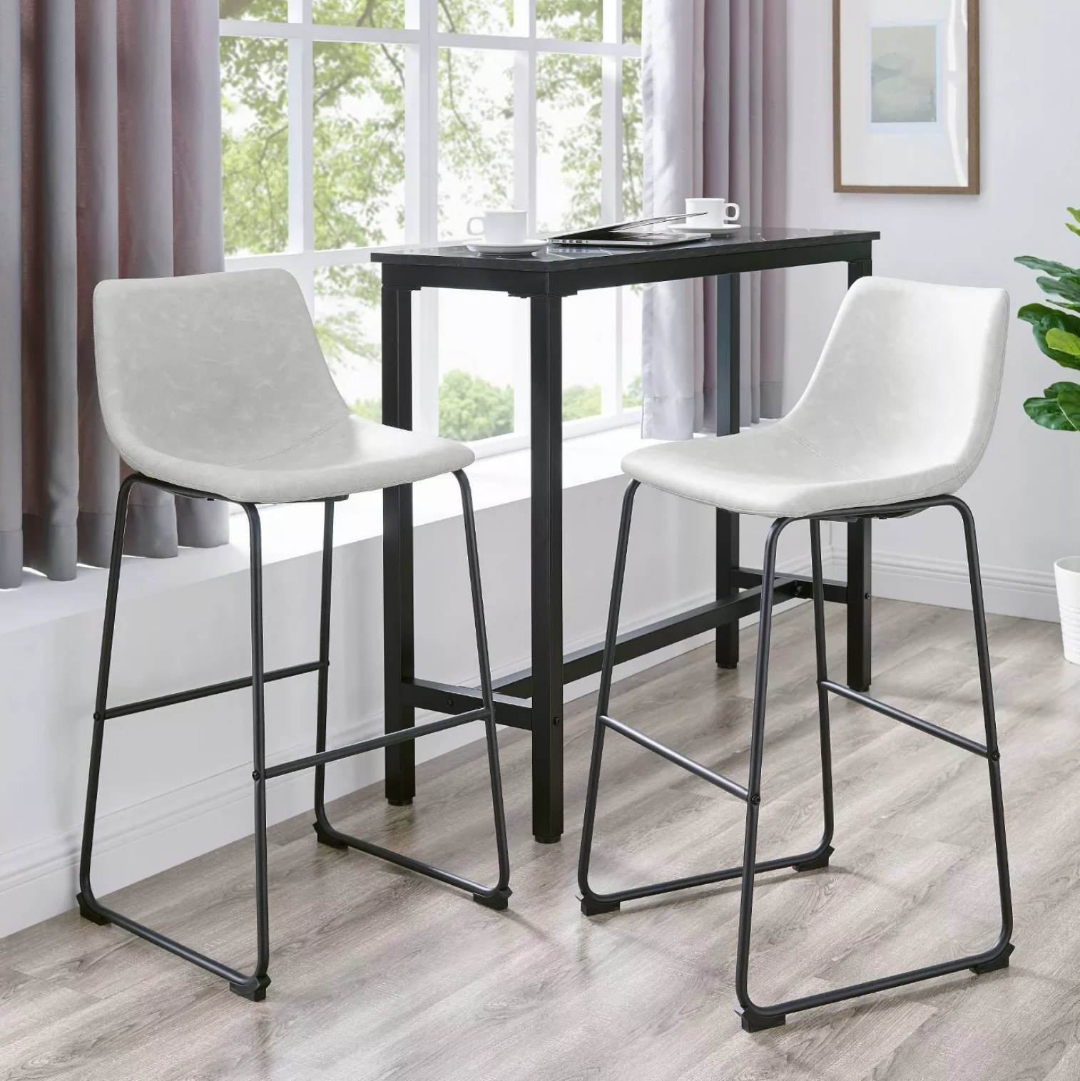 The gray stools by a black table