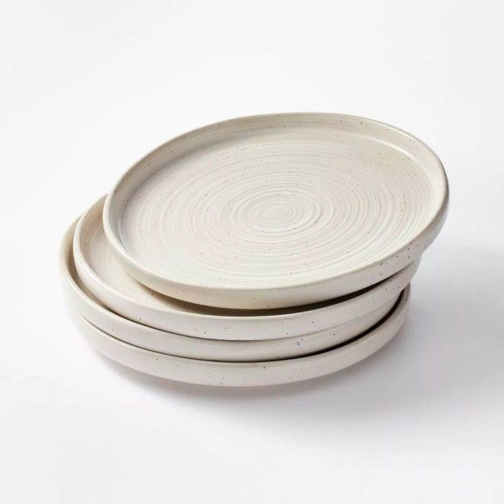 A set of four plates in cream