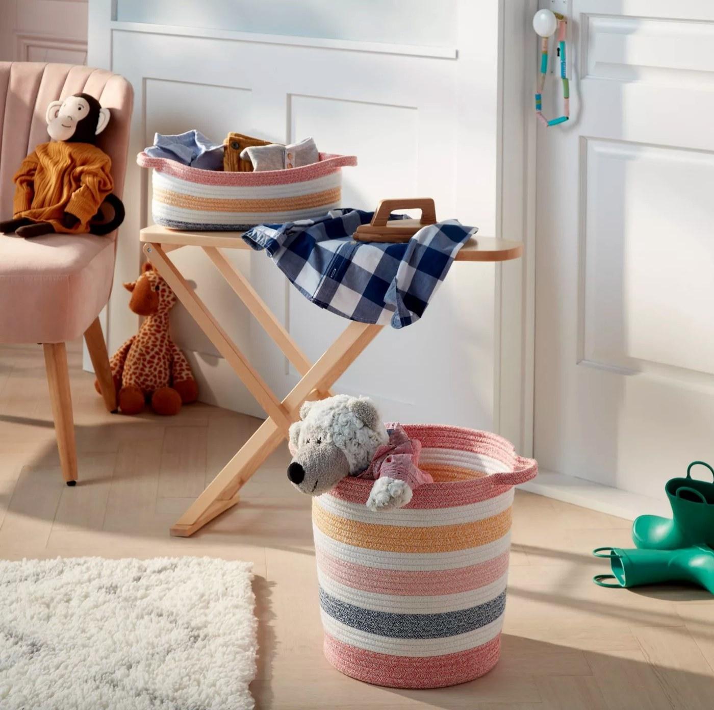 The multi-stripe rope storage bin holding children's toys