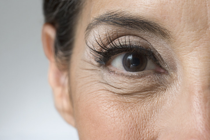 Close up of woman's eye with wrinkles underneath