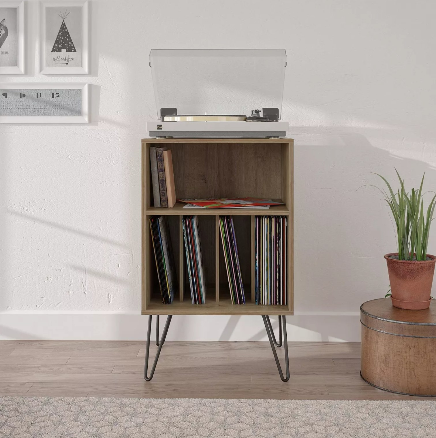 The record stand with vinyls and a record player on top