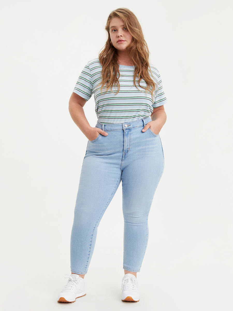 Model wearing the light wash blue jeans