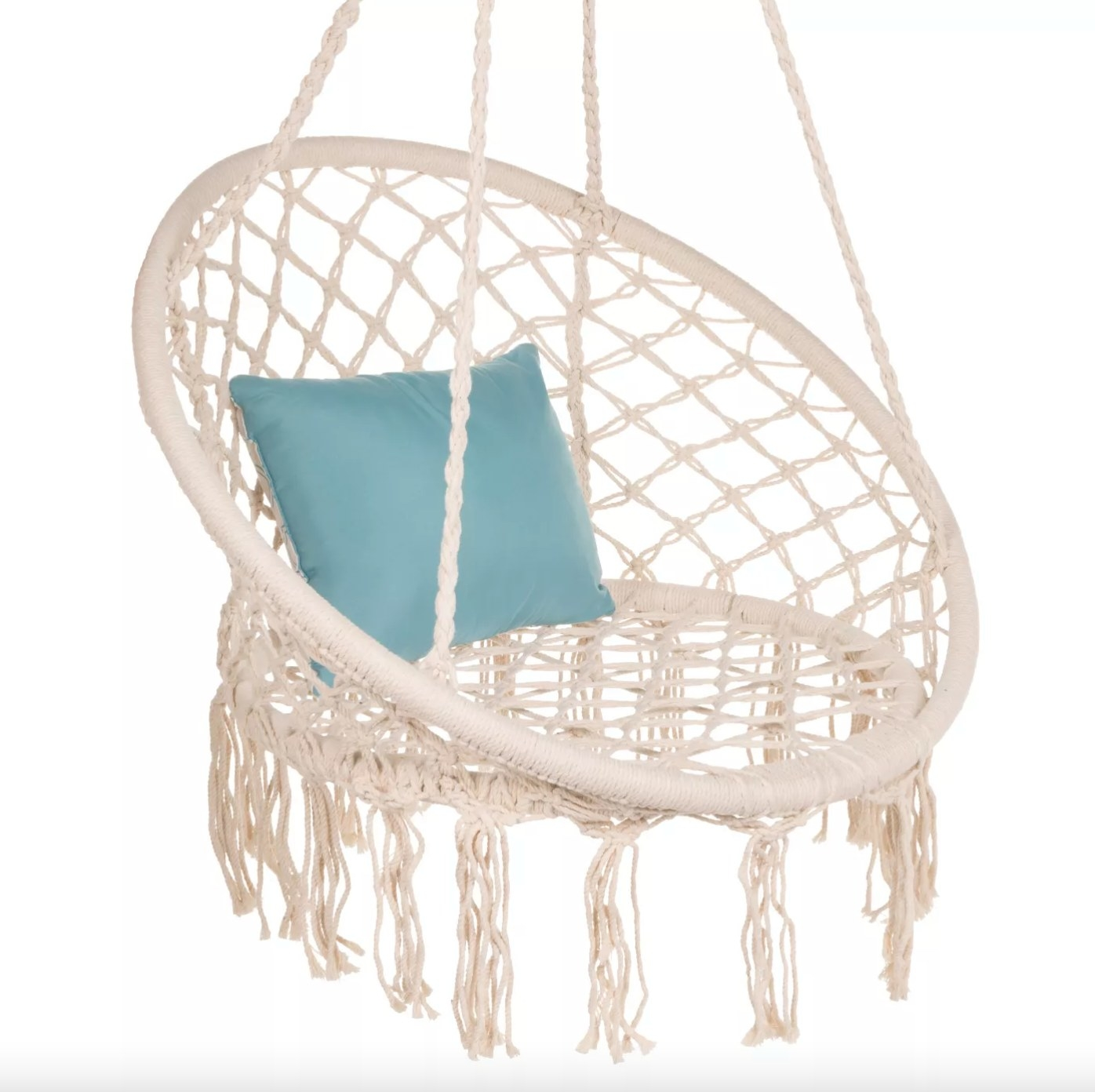 The macrame swing chair in beige with a blue pillow