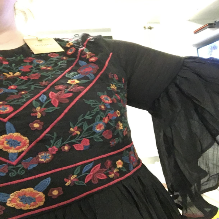 A customer review photo showing the detail of the embroider on the chest of the dress