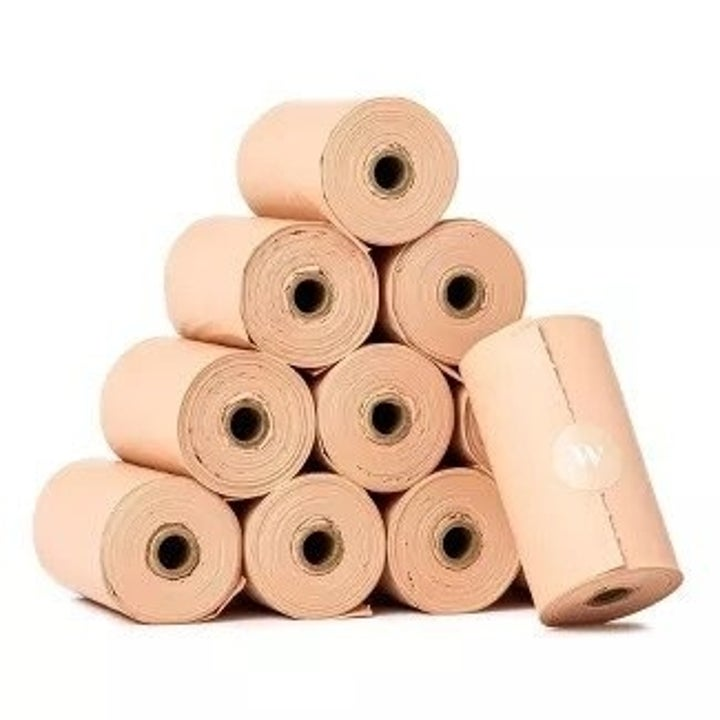 a pile of rolled-up poop bags