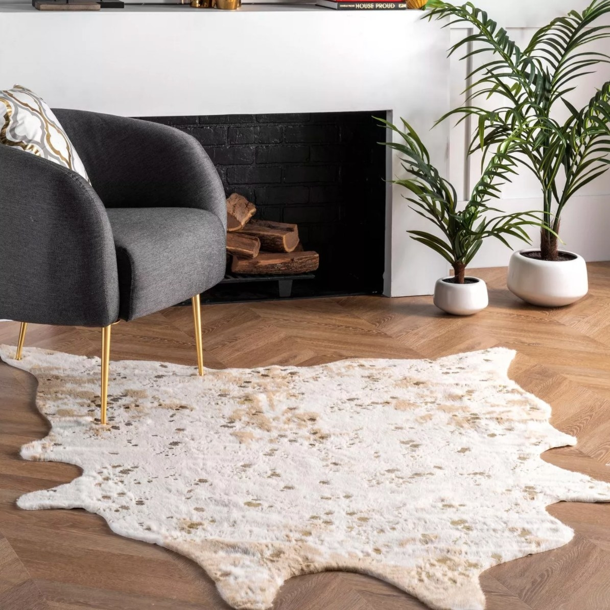 The faux cowhide area rug in offwhite