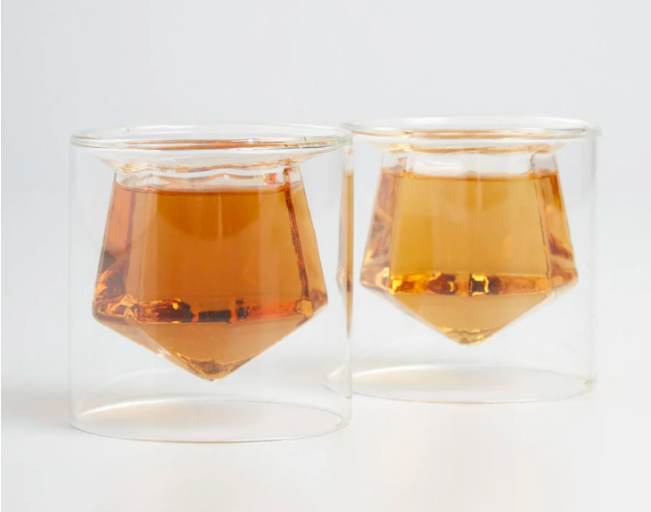 two shot glasses with inner chambers shaped like gems