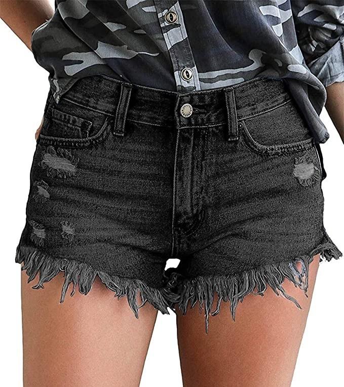 model wearing gray short shorts with frayed hem