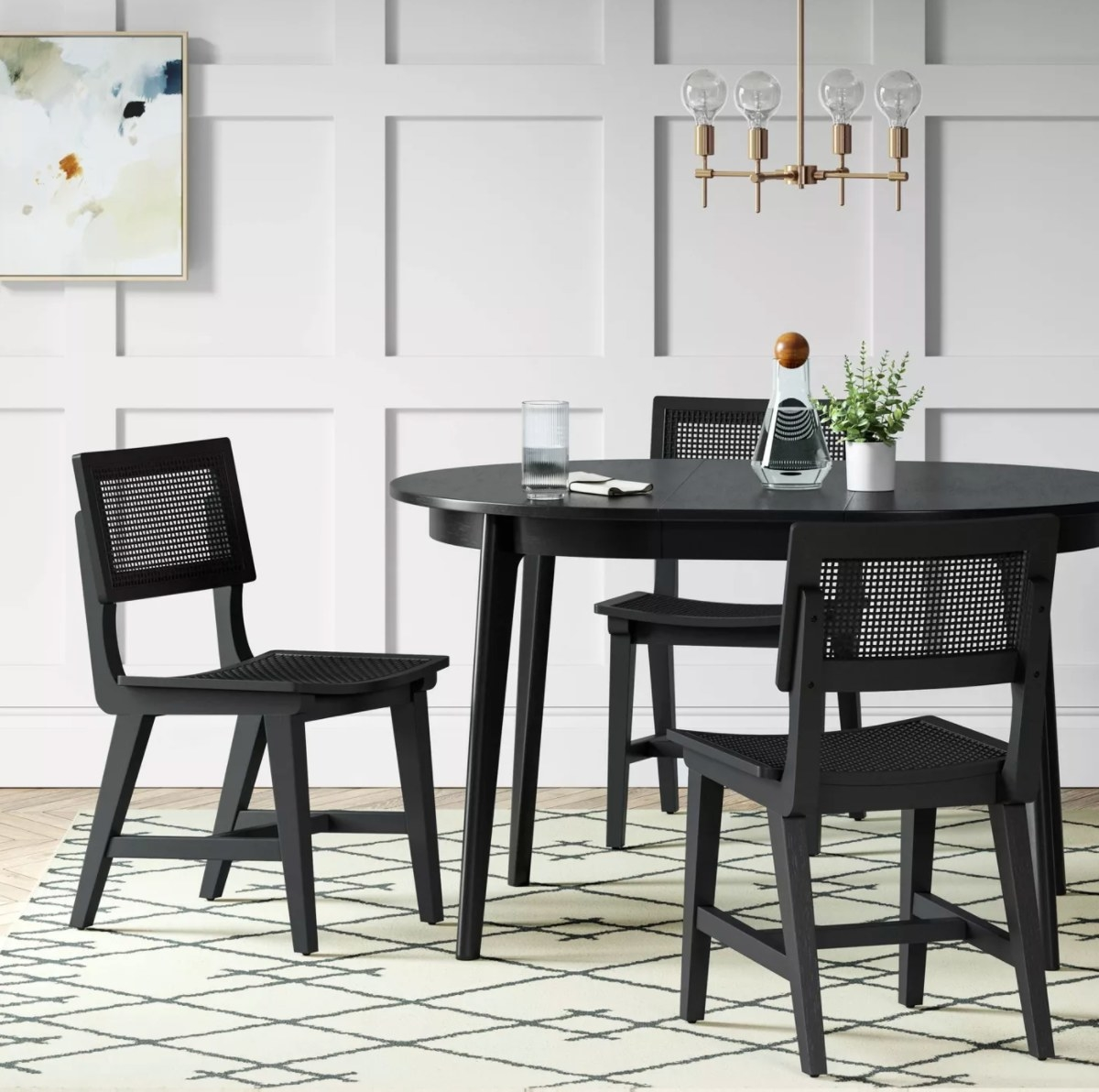 The midcentury round extendible table with matching chairs in black
