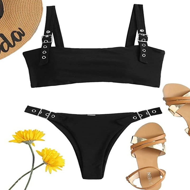 black bikini with a bandeau top and high waisted bottom with belt-like hardware accents on both the top and bottom