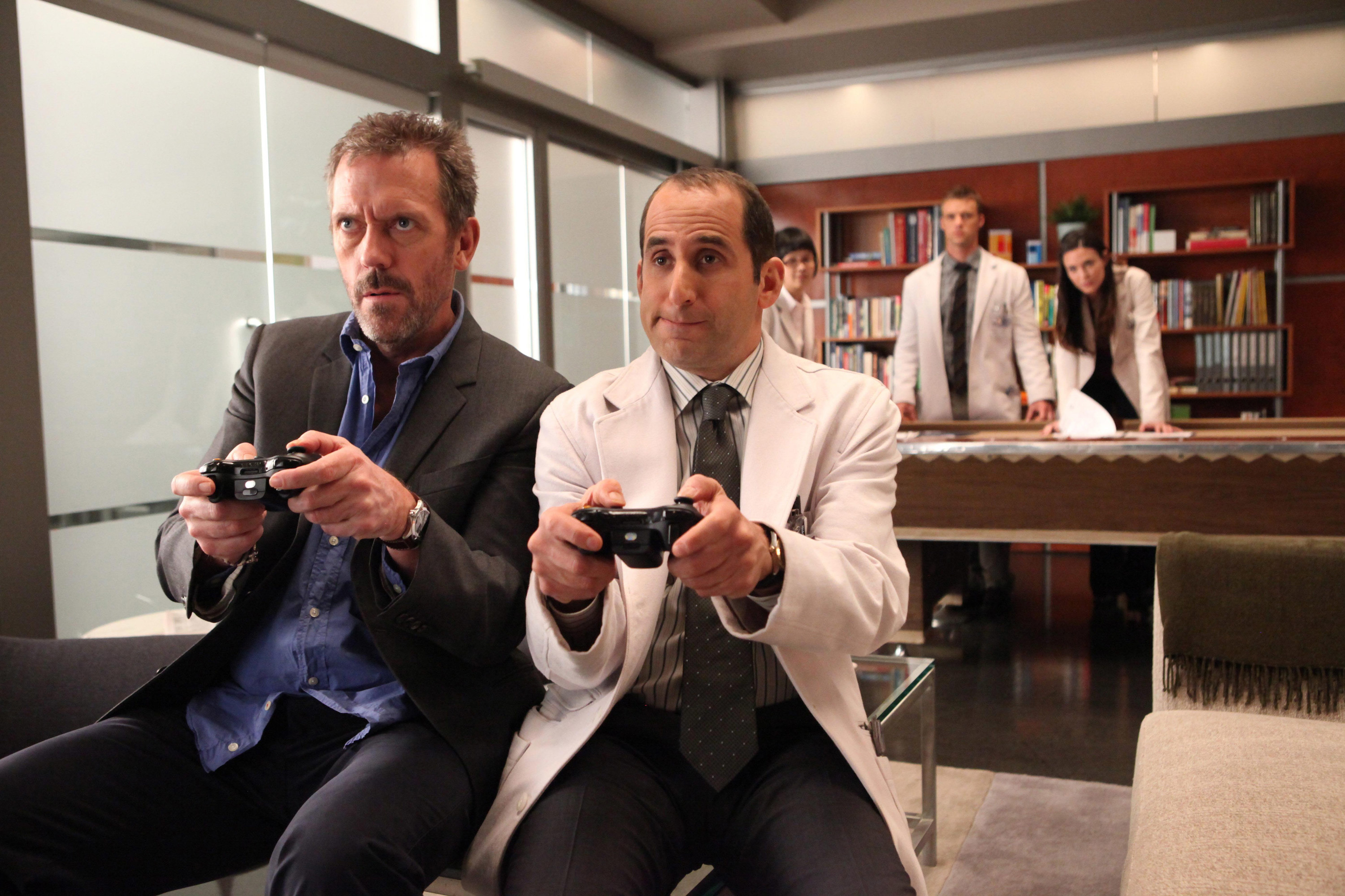 HOUSE, (from left): Hugh Laurie, Peter Jacobson, 'Blowing The Whistle', (Season 8, ep. 815, aired April 2, 2012), 2004-.