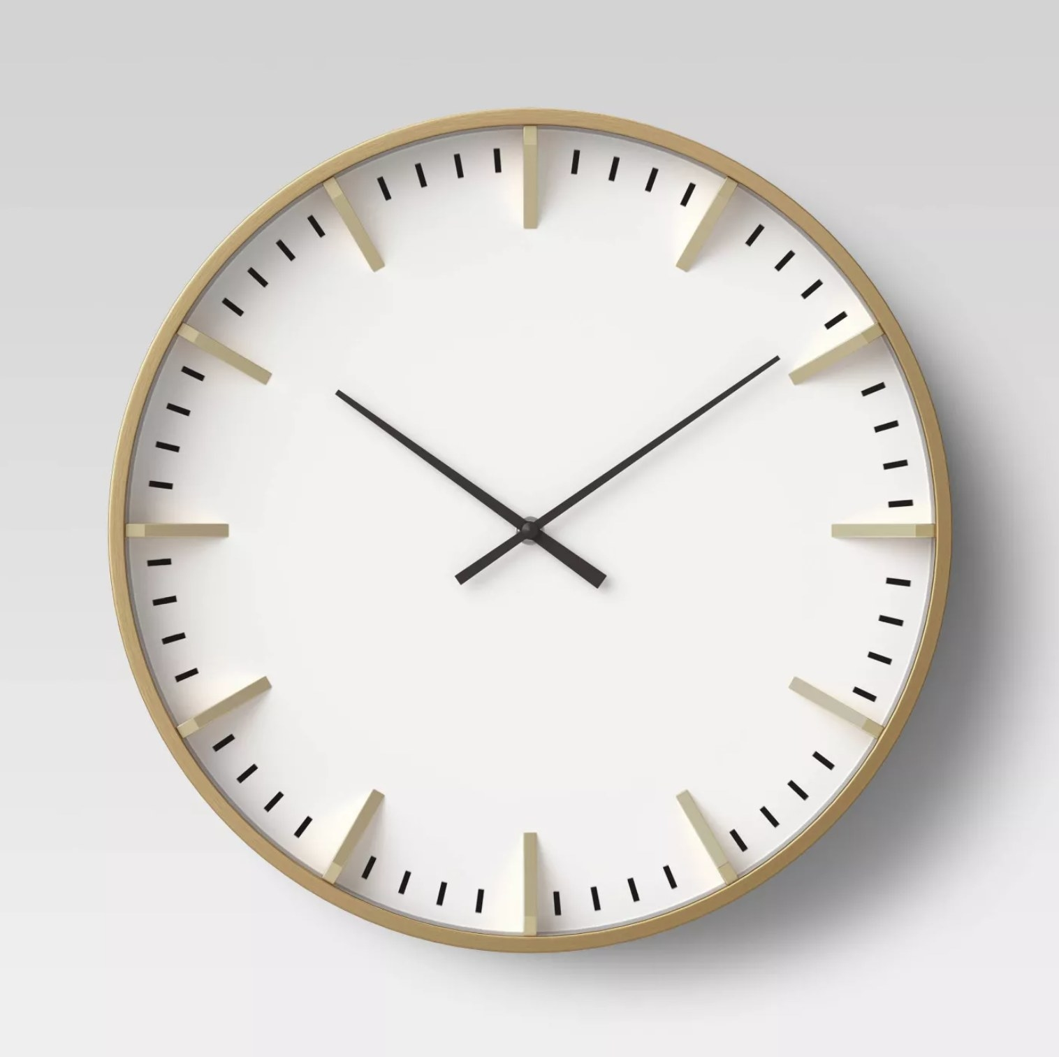 The white and brass clock